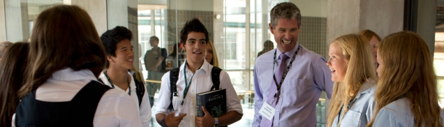 Head of Lakefield College School Struan Robertson chats with LCS students in the hallway