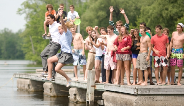Lakefield College School graduates leap into Lake Katchewanooka